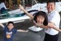 Pilot Hank Cheng Chor-hang, his son Cheng Yui-leung (left), and daughter Cheng Yui-yee, 8, with the plane that Cheng will fly across 50 countries. Photo: Dickson Lee