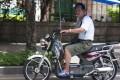 A man rides an e-bike in Shenzhen. Photo: Stuart Heaver