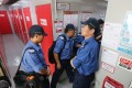 Firemen check fire protection system at a storage facility in Tai Kok Tsui. Photo: Felix Wong