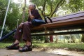 A old woman sit a bench in a park in Kennedy Town. Photo: SCMP