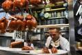 Singaporean chef Chan Hon Meng chops chicken at his Hong Kong Soya Sauce Chicken Rice and Noodle stall. Photo: AFP