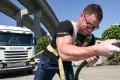 Gary Manwaring pulls an 8.7-tonne truck during a Kwai Chung curtain-raiser to the Arnold Classic Asia Multi-sport Festival. Photo: Edward Wong