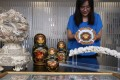 Fiona Fok, Manager of JLA Asia display auction items for former Chief Secretary Rafael Hui Si-yan in Central. Photo: Sam Tsang