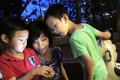 Josephine Lee and her two sons Gorden Lee (aged 5) and Louis Lee (aged 8) play Pokemon Go at Hoi Sham Park in To Kwa Wan. Photo: Nora Tam