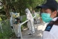 Government staff take action against mosquitoes in the New Territories in 2013. Photo: SCMP Pictures