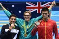 Gold medal winner Mack Horton of Australia celebrates with silver winner Sun Yang of China and Gabriele Detti of Italy. Photo: EPA