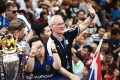 Leicester City football manager Claudio Ranieri waves to Thai supporters during an open-bus parade in Bangkok to celebrate his side winning the English Premier League. The club is owned by Thai billionaire Vichai Srivaddhanaprabha. Photo: AFP
