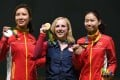 Virginia Thrasher, the US winner of the 10m air rifle, with silver medallist Du Li (left) and bronze medallist Yi Siling, both from China. Photo: AFP