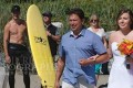 Shirtless Justin Trudeau (left) captured in the background of a wedding photograph in Tofino, BC. Photo: Marnie Recker / Twitter