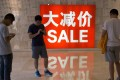 Men at a shopping centre in Beijing. Photo: Associated Press