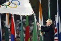 Then London mayor Boris Johnson waves the Olympic flag during the closing ceremony in the National Stadium at the 2008 Olympic Games in Beijing. Photo: Reuters