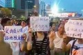 Thousands of residents Lianyungang, Jiangsu province turned out to protest plans to build a nuclear reprocessing plant on August 8. Photo: SCMP Pictures