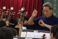 Gordon Siu Kwing-chue, founder of Music For Our Young Foundation (MOY), rehearses at Tin Shui Wai Methodist Primary School with its combined orchestra. Photo: Nora Tam