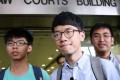 Joshua Wong Chi-fung, Nathan Law Kwun-chung and Alex Chow Yong-kang outside Eastern Court in Sai Wan Ho on Monday. Photo: Sam Tsang