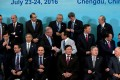 G20 finance ministers and central bank governors prepare for a group photo in Chengdu in China's Sichuan province, July 24, 2016. Photo: Reuters