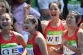China's Ge Manqi, Liang Xiaojing, Wei Yongli and Yuan Qiqi were denied a place in the 4x100m relay final in the cruellest of circumstances. Photo: AFP