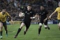 Beauden Barrett runs in to score a try for the All Blacks in their Rugby Championship clash with Australia in Sydney on Saturday. Photo: AP