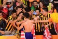 Malaysia's Lee Chong Wei celebrates with fans after defeating his great rival in the men's singles semi-final. Photo: AFP