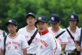 Liu Kai-chi (centre) as the school principal and baseball team coach in Weeds on Fire.