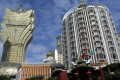 Tourists gather in front of Casino Lisboa in Macau. Photo: AP