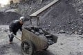 A worker pushes a cart at a coal mine owned by in Pinglu, Shanxi province. Photo: Reuters