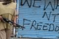 An Indian trooper holds a pellet gun as he patrols in Srinagar. Photo: AFP