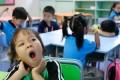 """Some of the pupils reaching Tsuen Wan Trade Association Primary School in Tsing Yi were two hours late. Photo"""" Xiaomei Chen"""