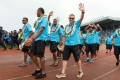 Fiji's rugby sevens coach Ben Ryan waving to the crowd during a victory ceremony. Photo: AFP