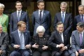 G7 finance ministers and central bank governors, including US Federal Reserve chief Janet Yellen (seated centre), IMF managing director Christine Lagarde (standing, far left) and European Central Bank president Mario Draghi (seated second right), get ready for a photo op in Sendai, Japan on May 20. Photo: EPA