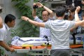 The body of Lotte Group vice-chairman Lee In-won is wheeled into an ambulance in Yangpyeong, South Korea, on August 26, 2016. Photo: Reuters