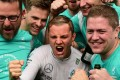 Nico Rosberg celebrates with his Mercedes team in the pit after winning the Italian Grand Prix at Monza. Photo: AFP
