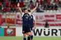 Hat-trick hero Robert Snodgrass of Scotland salutes the Scottish fans after scoring during the 2018 World Cup qualifier. Photo: EPA