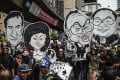 Student activists hold clown-faced caricatures of Malaysian Prime Minister Najib Razak (second right) and his wife Rosmah Mansor (second left) during a protest over the 1MDB scandal in Kuala Lumpur in August 2016. Photo: AFP