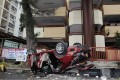 The car first landed on a tree 3.2 metres away from the building, before it plunged further onto metal railings lining the pavement on Tip King Road. Photo: SCMP Pictures