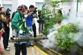 An official in Singapore spraying for mosquitoes that transmit the Zika virus in Singapore on Thursday. Photo: Kyodo