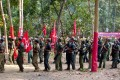 Maoist rebels march in the jungles of the Indian state of Chhatisgarh, 1,500km southeast of New Delhi. The rebels, who claim to be inspired by Chinese revolutionary Mao Zedong, have been fighting in several Indian states, demanding land and jobs for agricultural labourers and the poor. Photo: AP