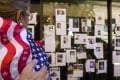 A woman looks at posters of people missing following the attack on the World Trade Centre in 2001. Photo: EPA