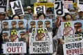 South Korean protesters with defaced pictures of North Korean leader Kim Jong-un stage a rally denouncing North Korea's latest nuclear test in Seoul, South Korea. Photo: AP