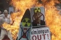 A defaced image of North Korean leader Kim Jong-un is burned by South Korean protesters during a rally denouncing North Korea's latest nuclear test, in Seoul, South Korea. Photo: AP