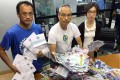 (From left) Voter Circle Fong, The Green Earth's environmental advocacy director Hahn Chu Hong-keung and Support HK programme manager Kelly Chan are calling on the government help cut down on paper waste. during elections. Photo: SCMP Pictures