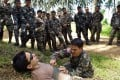 Two US Army Special Forces members conduct tactical combat casualty care training for Philippine Army soldiers (background) in Mindanao. File photo: AFP