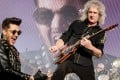 Brian May (right) and Adam Lambert perform in Italy earlier this year.