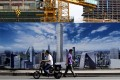 A Beijing construction site wall depicting the future skyline of the Chinese capital. Photo: AP