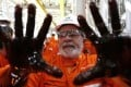 Brazilian former president Luiz Inacio Lula da Silva poses with his hands covered in oil in 2010 as he takes part in the launch of an oil platform owned by Petrobras, the state-run energy company now at the centre of a vast corruption scandal. Photo: EPA
