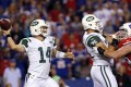 New York Jets quarterback Ryan Fitzpatrick (14) throws a pass under pressure from Buffalo Bills defensive tackle Kyle Williams (95) as offensive guard Wesley Johnson (76) blocks. Photo: USA Today