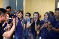Staff greet a customer as he arrives to purchase an iPhone 7 at an Apple store in Beijing. Photo: Reuters