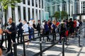 Customers wait in line to buy the new iPhone 7 smartphone outside an Apple store in New York. Photo: Reuters
