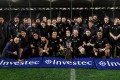 New Zealand players celebrate winning the Freedom Cup after their win over South Africa. Photo: AFP