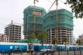 A housing construction site in Shanghai, which led gains in China's home prices in August, with a 5.2 per cent monthly increase. Photo: AFP