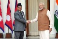 Indian Prime Minister Narendra Modi (right) greets Nepali counterpart Pushpa Kamal Dahal in New Delhi on September 16. Photo: EPA